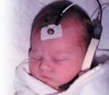 A baby getting a hearing screening test